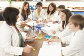 Group Of Teenage Students In Science Class With Tutor — Stock Photo