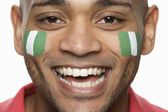 Young Male Sports Fan With Nigerian Flag Painted On Face — Stock Photo