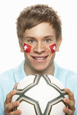 Young Male Football Fan With Swiss Flag Painted On Face — Stock Photo