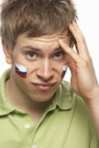 Disappointed Young Male Sports Fan With Slovakian Flag Painted O — Stock Photo
