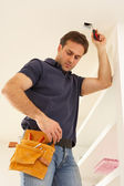 Electrician Installing Light Fitting In Home — Stock Photo