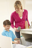 Mother And Son Recyling Waste At Home — Stock Photo