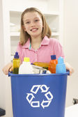 Girl Holding Recyling Waste Bin At Home — Stock Photo