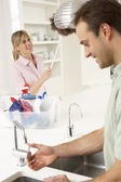 Couple Doing Housework In Kitchen Together — Stok fotoğraf