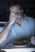 Frightened Man Enjoying Meal Whilst Watching TV — Stock Photo