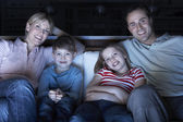 Family Watching TV On Sofa Together — Stock Photo