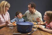 Family Enjoying Meal Together At Home — Foto de Stock