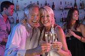 Senior Couple Having Fun In Busy Bar — Stock Photo