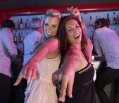 Two Young Women Having Fun In Busy Bar — Stock Photo