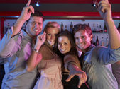 Group Of Young Having Fun In Busy Bar — Stock Photo