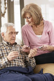Senior Woman Caring For Sick Husband — Stock Photo