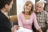 Senior Couple Talking With Financial Advisor — Stock Photo