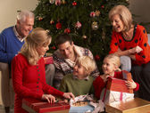 Three Generation Family Opening Christmas Gifts At Home — Zdjęcie stockowe