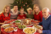 Three Generation Family Enjoying Christmas Meal At Home — Stock Photo
