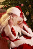 Santa Claus Making Rude Gesture To Camera In Front Of Christmas Tree — Stock Photo