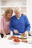 Senior Couple Making Sandwich In Kitchen — Stock Photo