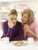 Mother Consoling Grown Up Daughter — Stock Photo