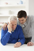 Grown Up Son Consoling Senior Parent — Stok fotoğraf