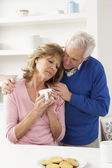 Senior Man Consoling Wife — Stock Photo