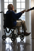Disabled Senior Man Sitting In Wheelchair Being Handed Cup — Stock Photo