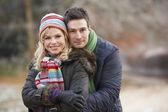 Couple On Romantic Winter Walk Through Frosty Landscape — Stock Photo
