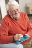 Senior Man Sorting Medication Using Organiser At Home — Stock Photo