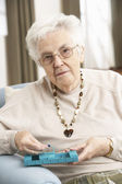 Senior Woman Sorting Medication Using Organiser At Home — Stock Photo