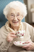 Senior Woman Enjoying Cup Of Tea At Home — Stock Photo
