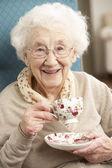 Senior Woman Enjoying Cup Of Tea At Home — Stock Photo