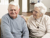 Senior Woman Consoling Husband At Home — Stock Photo