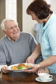 Senior Man Being Served Meal By Carer — Stock Photo