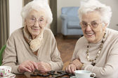 Two Senior Women Playing Dominoes At Day Care Centre — Stok fotoğraf