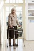 Elderly Senior Woman Using Walking Frame — Stock Photo