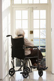 Disabled Senior Woman Sitting In Wheelchair — Stock Photo