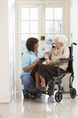 Carer With Disabled Senior Woman Sitting In Wheelchair — Stock Photo
