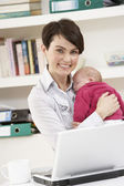 Woman With Newborn Baby Working From Home Using Laptop — Stock Photo