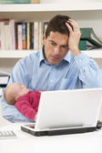 Stressed Father With Newborn Baby Working From Home Using Laptop — Stock Photo