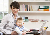 Woman With Baby Working From Home Using Laptop — Stock Photo
