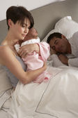 Mother Cuddling Newborn Baby In Bed At Home — Stock Photo