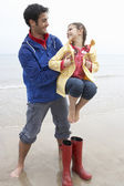 Father and daughter on beach — Stok fotoğraf