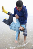 Happy father with son on beach — Stok fotoğraf