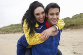 Happy couple on beach in love — Stock Photo
