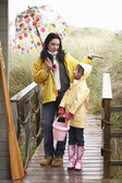 Mother and daughter with umbrella — Stok fotoğraf