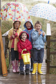 Children posing with umbrella — Foto Stock