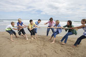 Teenagers playing tug of war — Stok fotoğraf