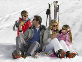 Young Family Sharing A Picnic On Ski Vacation — Stock Photo