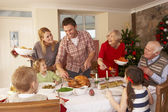 Family serving Christmas dinner — Stock Photo