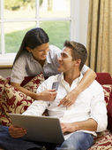 Young Hispanic couple shopping online — Stock Photo