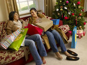 Hispanic mother and daughter resting after Christmas shopping — Stock Photo