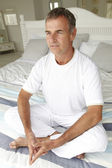 Mid age man in lotus position — Stock Photo